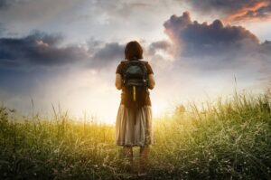 Woman with backpack representing Enneagram Transformation