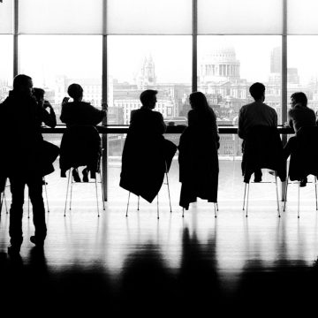 Silhouette of people in office setting representing Corporate Enneagram Training